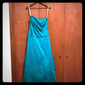 Teal prom dress with bustled back.